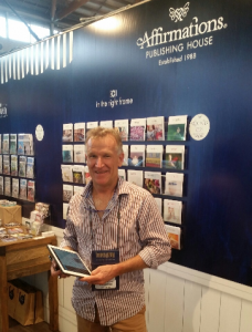 Affirmations Director, Dan Maher looks at home using PixSell to capture a customer order at Home & Giving Sydney 2015