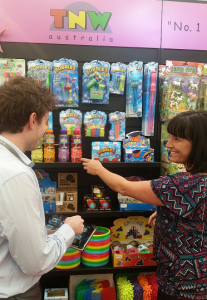 Tim and Christy from TNW Australia at Reed Gift Fair taking an order with PixSell